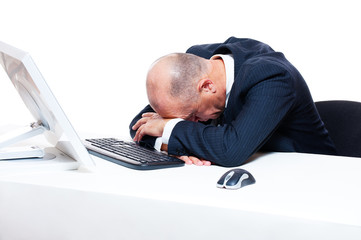 tired businessman sleeping on his workplace