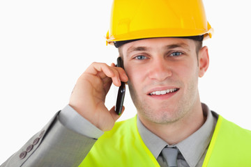 Close up of a builder making a phone call