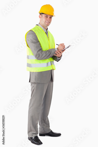 Portrait of a smiling contractor taking notes