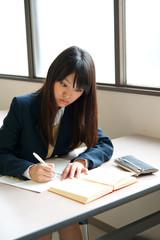 asian high schoolgirl studying