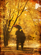 Couple walking at alley in autumn park.