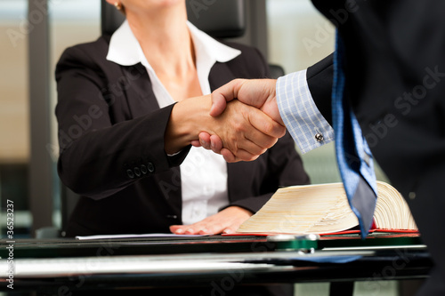 Female Lawyer or notary in her office
