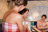 Three friends in sauna of a thermal bath