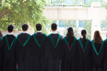 Back of university graduates with their gowns