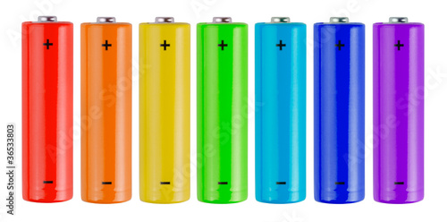 Leinwanddruck Bild Row of rainbow colors batteries isolated on white