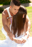 young couple happy embrace on grass, love relationship