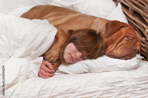 Girl and her dog in the bed
