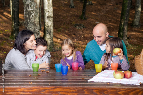 Happy family having fun outside in autumn