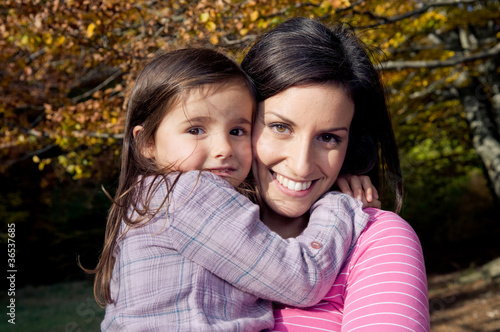 Mother and daughter outdoors on a autumn day