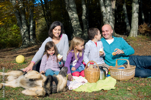 Happy family having picnic in autumn
