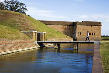 Tourist walking to Fort Pulaski