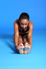 Beautiful African fit woman hamstring stretch