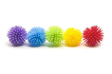 Five Colorful Stess Koosh Balls in a line