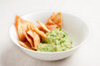 Bowl with guacamole and nachos