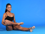 Beautiful African American woman leg exercise