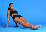 Body stretch by beautiful African American woman