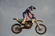 The spectacular jump motocross racer on a motorcycle