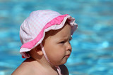 Portrait of a cute toddler girl at the swimming pool