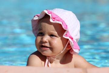 Cute toddler girl at the swimming pool