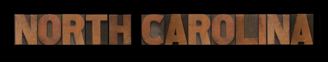 the words North Carolina in old wood type