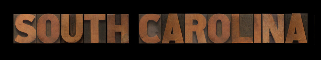 the words South Carolina in old wood type
