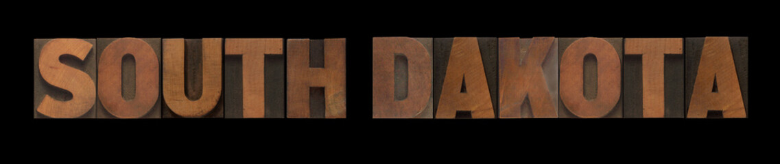 the words South Dakota in old wood type