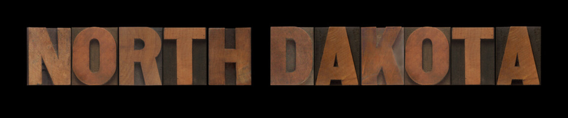 the words North Dakota in old wood type