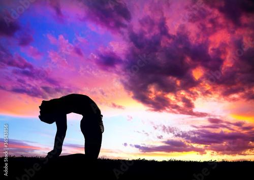 Yoga silhouette camel pose