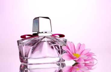 women's perfume in beautiful bottle and flower