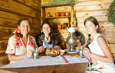 Women near  traditional  samovar