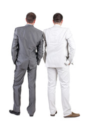 Back view of Two business men.  Rear view.