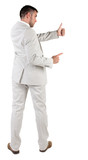 Back view of young business man in white suit going thumb up