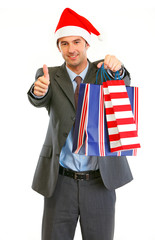 Happy businessman in Santa Hat with shopping bags