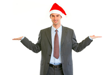 Businessman in Santa Hat holding on each side empty hands
