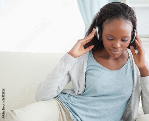 Fotobehang Muziek Close up of woman listening to music