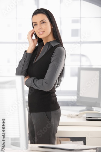 Elegant businesswoman on mobile call