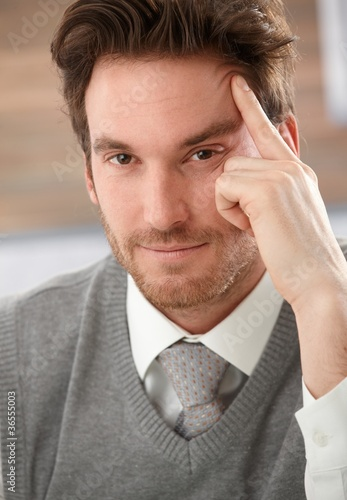 Closeup portrait of thinking businessman