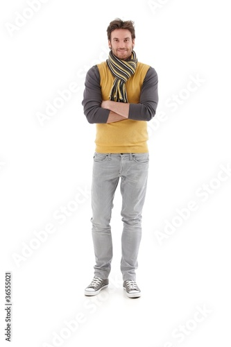 Confident man smiling arms crossed