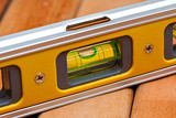 Spirit level over wooden boards