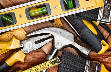 Set of manual tools over wooden boards