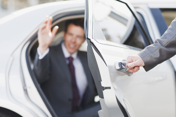 Politician emerging from limo