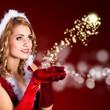 Miss Santa mit magischem Lichtball