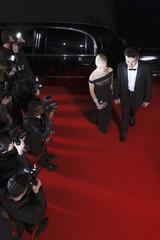 Celebrities walking on red carpet