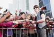 Celebrity signing autographs for fans