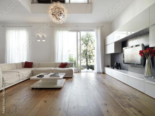 Leinwandbild Motiv moderno soggiorno con porta finestra aperta sul giardino
