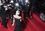 Celebrity posing for paparazzi on red carpet