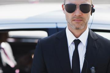Bodyguard wearing earpiece