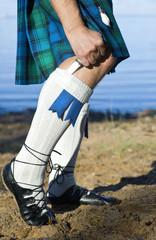 Legs of the man in kilt
