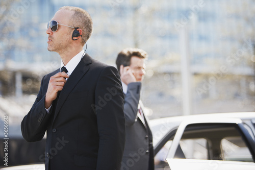 Bodyguard talking into earpiece