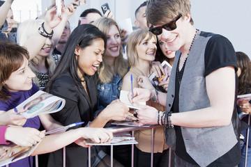 Celebrity signing autographs